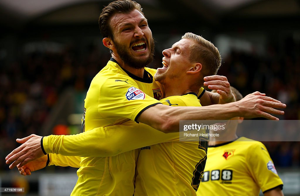 Matej Vydra (R) of Watford celebrates scoring his team's first goal with his team mate Marco Motta during the Sky Bet Championship match between Watford and Sheffield Wednesday at Vicarage Road on May 2, 2015 in Watford, England.
