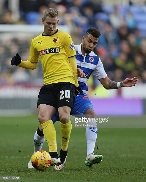 Matej Vydra of Watford holds off pressure from Danny Williams of Reading qduring the Sky Bet Championship match between Reading and Watford at...