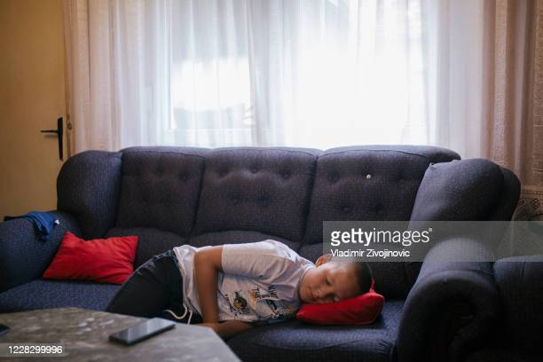 Mateja Brkljac, 12 years old, is sleepy and its difficult for him to go on his first day back to school on September 1, 2020 in Jagnjilo, Serbia....