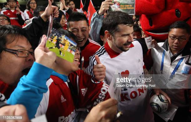 Mateja Kezman of South China poses for photos with fans after the match against Guangzhou RF at Asian Challenge Cup in Hong Kong Stadium 26JAN12