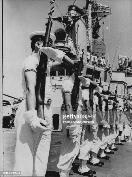Matelots present arms as Jeanne D'Arc enters Sydney Heads in reply to army gun salute from Nth head January 11 1965