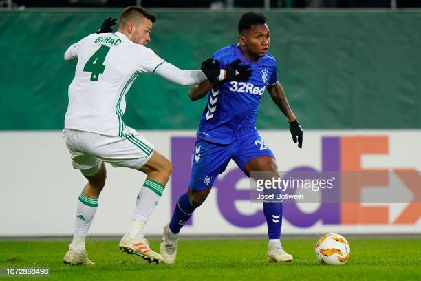 Mateo Barac of Rapid and Alfredo Morelos of Rangers during the UEFA Europa League match between SK Rapid Wien v Rangers at Weststadion on December 13...