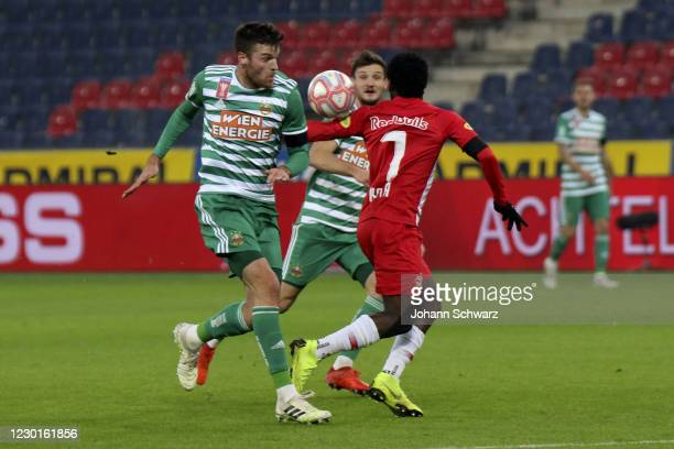 Mateo Barac of Rapid and Sekou Koita of Salzburg during Uniqua OeFB Cup Round of 16 match between RB Salzburg and SK Rapid Wien at Red Bull Arena on...