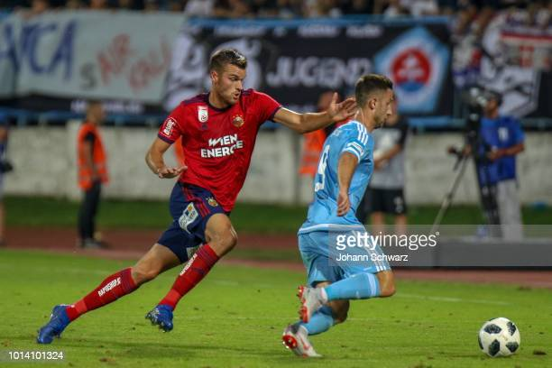 Mateo Barac of Rapid challenges Andraz Sporar of Slovan Bratislava during the UEFA Europa League third Qualifying Round 1st Leg match between Slovan...