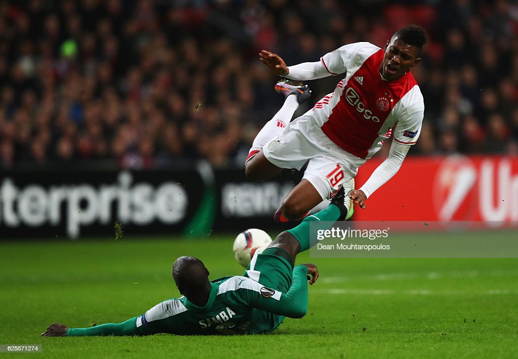 Mateo Cassierra of Ajax is challenged by Christopher Samba of Panathinaikos during the UEFA Europa League Group G match between AFC Ajax and Panathinaikos FC at Amsterdam Arena on November 24, 2016 in Amsterdam, Netherlands.