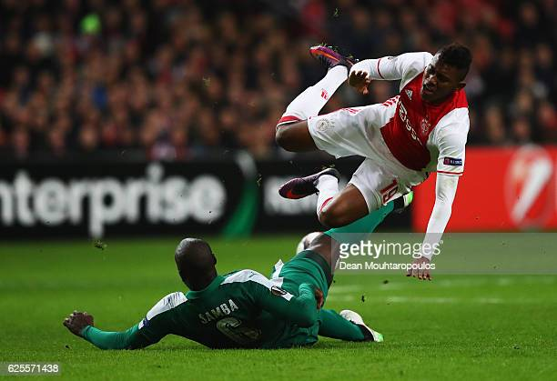 Mateo Cassierra of Ajax is challenged by Christopher Samba of Panathinaikos during the UEFA Europa League Group G match between AFC Ajax and...