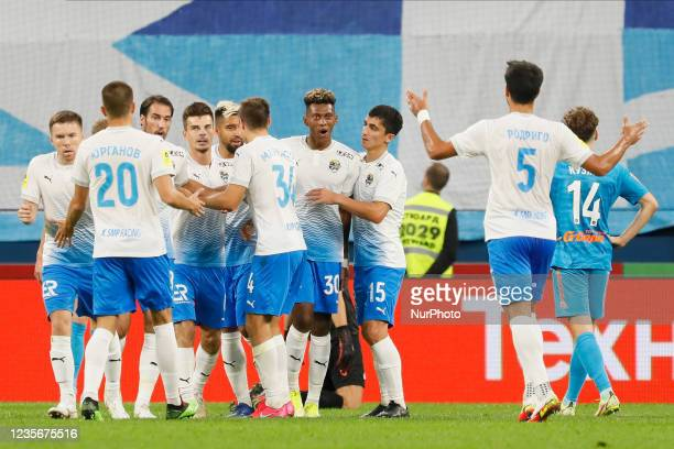 Mateo Cassierra of Sochi celebrates his goal with teammates during the Russian Premier League match between FC Zenit Saint Petersburg and FC Sochi on...