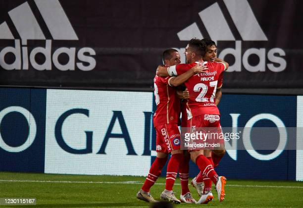 Mateo Coronel of Argentinos Juniors celebrates with teammates after scoring the first goal of his team during a match between River Plate and...