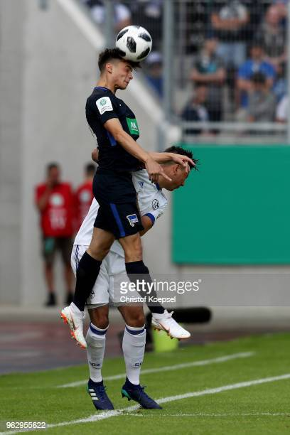 Mateo Kastrati of Berlin and Andriko Smolinski of Schalke go up for a header during the German A Juniors Championship Final between FC Schalke 04 U19...