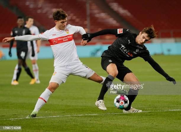 Mateo Klimowicz of VfB Stuttgart and Florian Neuhaus of Borussia Moenchengladbach battle for possession during the Bundesliga match between VfB...