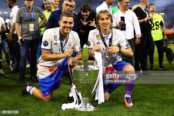 Mateo Kovacevic and Luka Modric of Real Madrid pose with the trophy following the UEFA Champions League Final match between Juventus and Real Madrid...