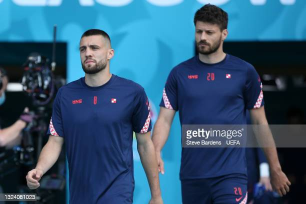 Mateo Kovacic and Bruno Petkovic of Croatia make their way towards the pitch prior to the Croatia Training Session ahead of the UEFA Euro 2020 Group...