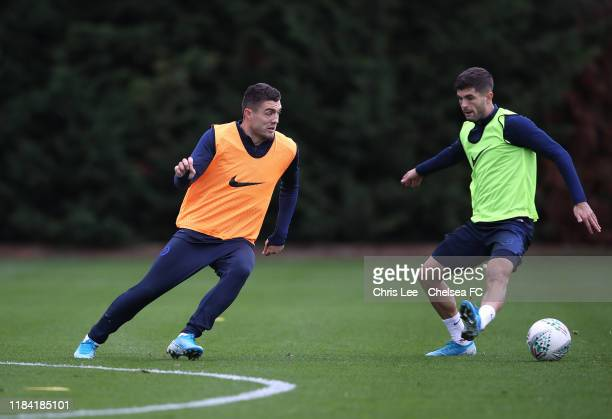 Mateo Kovacic and Christian Pulisic in action at Chelsea Training Ground on October 29 2019 in Cobham England