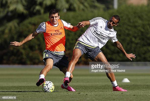 Mateo Kovacic and Danilo of Real Madrid in action during a training session at Valdebebas training ground on August 28 2015 in Madrid Spain