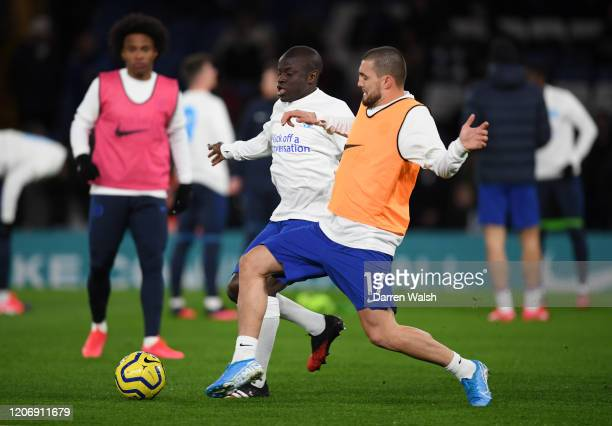 Mateo Kovacic and N'Golo Kante of Chelsea warm up prior to the Premier League match between Chelsea FC and Manchester United at Stamford Bridge on...