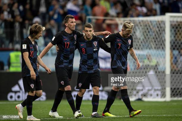 Mateo Kovacic Ivan Rakitic and Mario Mandzukic of Croatia celebrate after winning the 2018 FIFA World Cup Russia Group D match against Argentina at...