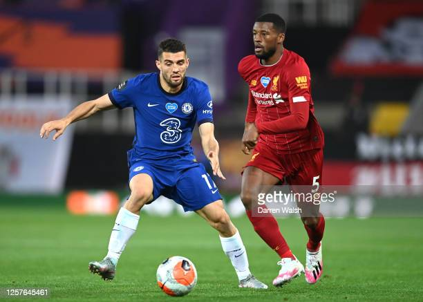 Mateo Kovacic of Chelsea and Georginio Wijnaldum of Liverpool battle for the ball during the Premier League match between Liverpool FC and Chelsea FC...