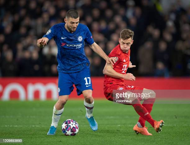 Mateo Kovacic of Chelsea and Joshua Kimmich of FC Bayern Munchen in action during the UEFA Champions League round of 16 first leg match between...