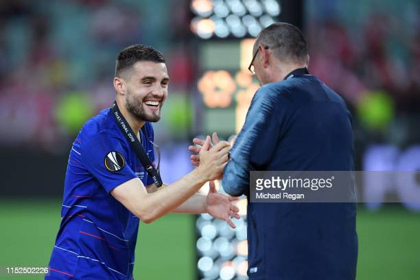 Mateo Kovacic of Chelsea and Maurizio Sarri Manager of Chelsea celebrate following their sides victory in the UEFA Europa League Final between...