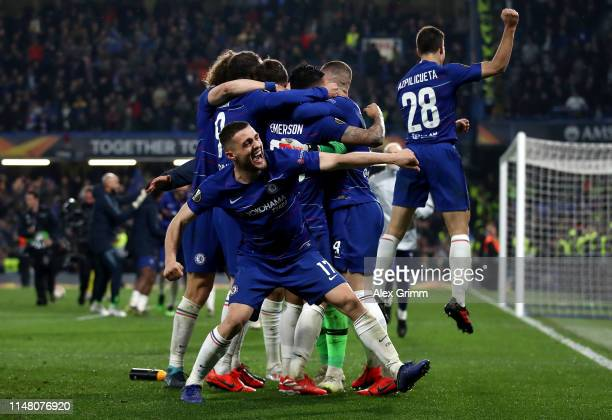 Mateo Kovacic of Chelsea and teammates celebrate victory in the shoot out after the UEFA Europa League Semi Final Second Leg match between Chelsea...
