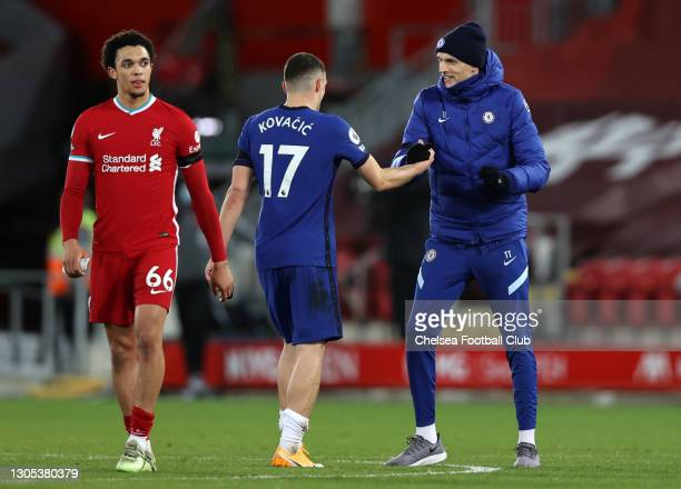 Mateo Kovacic of Chelsea and Thomas Tuchel, Manager of Chelsea celebrate following their team's victory in the Premier League match between Liverpool...