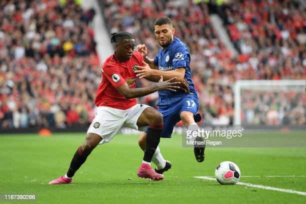 Mateo Kovacic of Chelsea battles for possession with Aaron WanBissaka of Manchester United during the Premier League match between Manchester United...