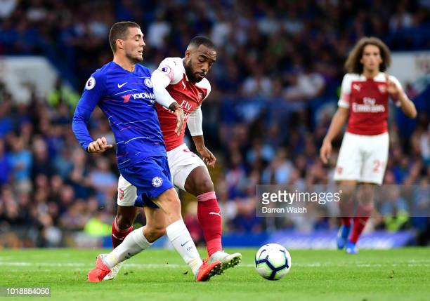 Mateo Kovacic of Chelsea battles for possession with Alexandre Lacazette of Arsenal during the Premier League match between Chelsea FC and Arsenal FC...