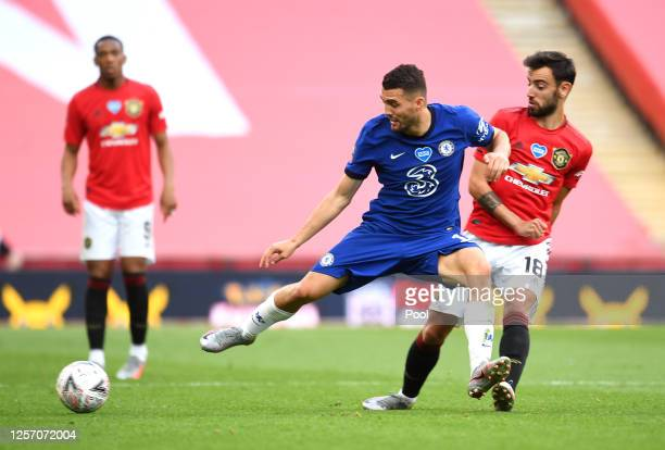 Mateo Kovacic of Chelsea battles for possession with Bruno Fernandes of Manchester United during the FA Cup Semi Final match between Manchester...