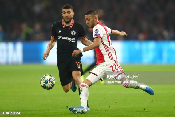 Mateo Kovacic of Chelsea battles for the ball with Hakim Ziyech of Ajax during the UEFA Champions League group H match between AFC Ajax and Chelsea...