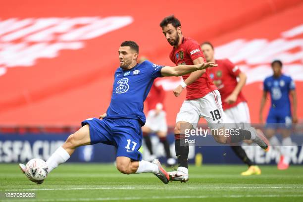 Mateo Kovacic of Chelsea controls the ball as Bruno Fernandes of Manchester United looks on during the FA Cup Semi Final match between Manchester...