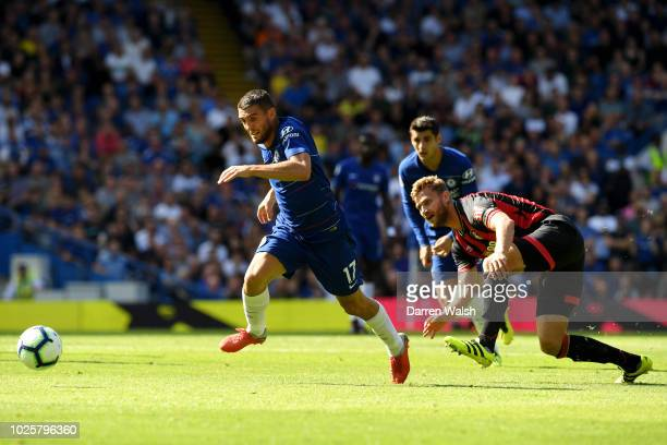 Mateo Kovacic of Chelsea gets away from Simon Francis of AFC Bournemouth during the Premier League match between Chelsea FC and AFC Bournemouth at...
