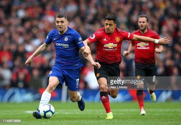 Mateo Kovacic of Chelsea holds off Alexis Sanchez of Manchester United during the Premier League match between Manchester United and Chelsea FC at...