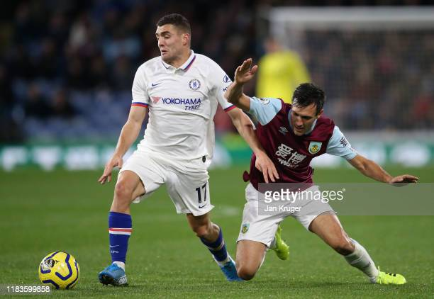 Mateo Kovacic of Chelsea is challenged by Jack Cork of Burnley during the Premier League match between Burnley FC and Chelsea FC at Turf Moor on...
