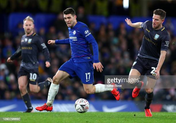 Mateo Kovacic of Chelsea is challenged by Sam Hutchinson of Sheffield Wednesday during the FA Cup Fourth Round match between Chelsea and Sheffield...