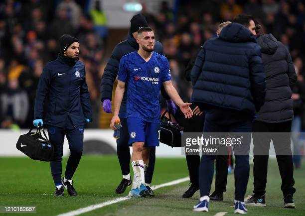 Mateo Kovacic of Chelsea leaves the pitch following an injury during the FA Cup Fifth Round match between Chelsea FC and Liverpool FC at Stamford...