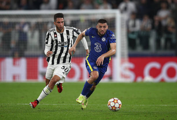 Mateo Kovacic of Chelsea runs with the ball whilst under pressure from Rodrigo Bentancur of Juventus during the UEFA Champions League group H match...