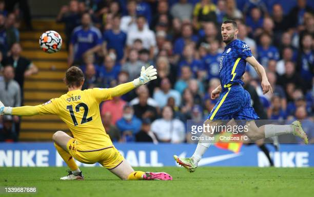 Mateo Kovacic of Chelsea scores their side's second goal past Jed Steer of Aston Villa during the Premier League match between Chelsea and Aston...