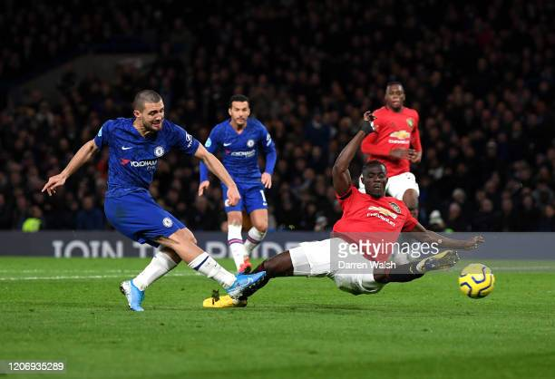 Mateo Kovacic of Chelsea shoots past Eric Bailly of Manchester United during the Premier League match between Chelsea FC and Manchester United at...