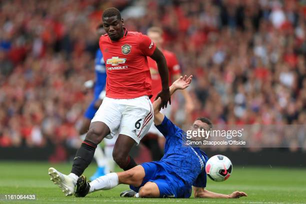 Mateo Kovacic of Chelsea tackles Paul Pogba of Man Utd during the Premier League match between Manchester United and Chelsea at Old Trafford on...