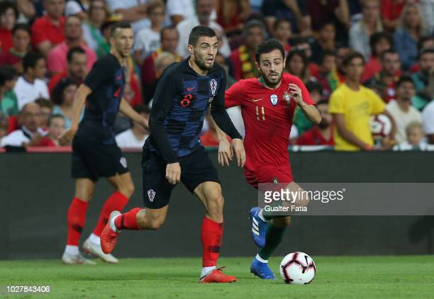 Mateo Kovacic of Croatia and Chelsea with Bernardo Silva of Portugal and Manchester City in action during the International Friendly match between...