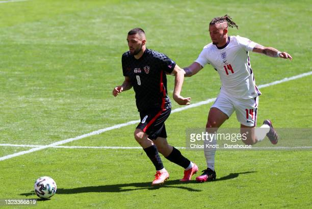 Mateo Kovacic of Croatia and Kalvin Phillips of England battle for the ball during the UEFA Euro 2020 Championship Group D match between England and...