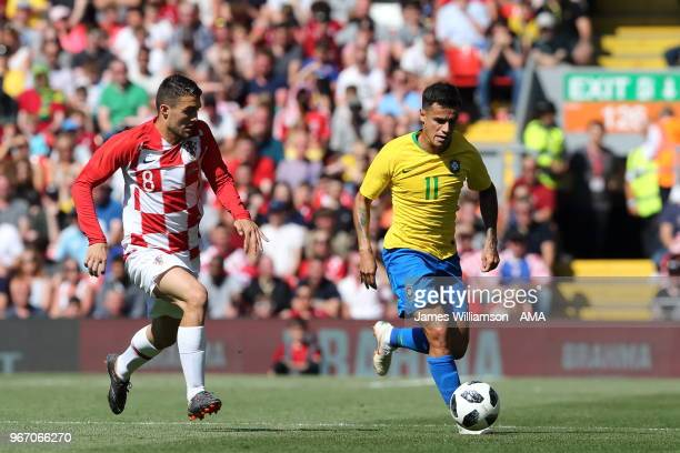 Mateo Kovacic of Croatia and Philippe Coutinho of Brazil during the International friendly match between Croatia and Brazil at Anfield on June 3 2018...