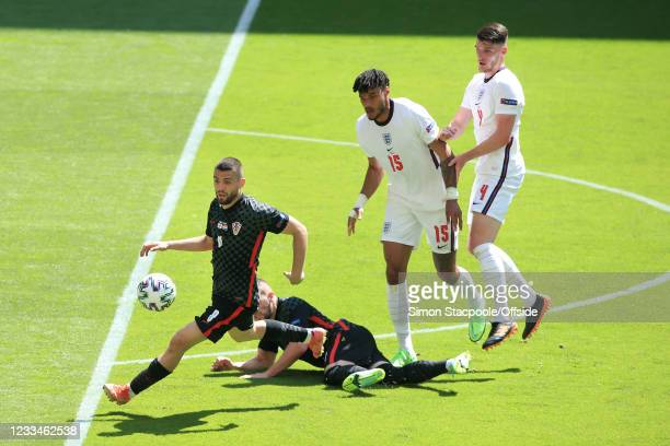 Mateo Kovacic of Croatia battles with Tyrone Mings of England and Declan Rice of England during the UEFA Euro 2020 Championship Group D match between...