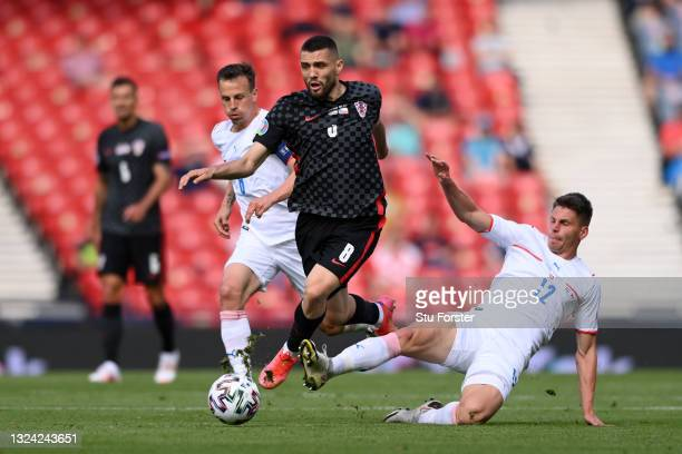 Mateo Kovacic of Croatia evades the challenge of Lukas Masopust of Czech Republic during the UEFA Euro 2020 Championship Group D match between...
