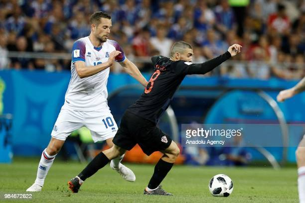Mateo Kovacic of Croatia in action against Gylfi Sigurdsson of Iceland during the 2018 FIFA World Cup Russia Group D match between Iceland and...