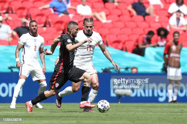 Mateo Kovacic of Croatia in action against Kalvin Phillips of England during the UEFA Euro 2020 Championship Group D match between England and...
