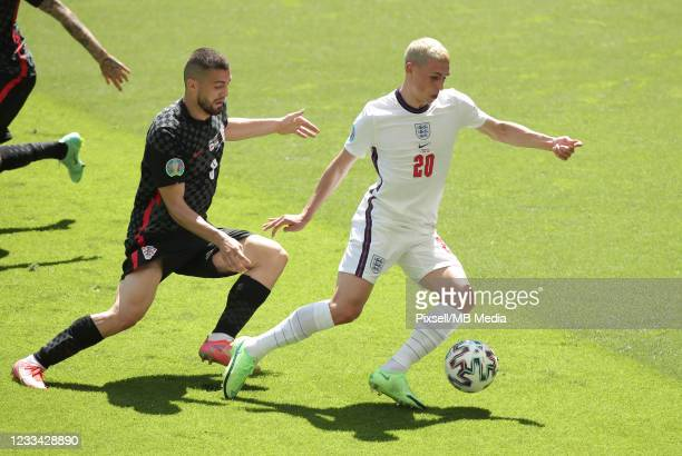 Mateo Kovacic of Croatia in action against Phil Foden of England during the UEFA Euro 2020 Championship Group D match between England and Croatia on...