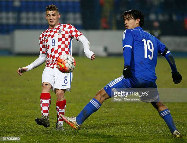 Mateo Kovacic of Croatia in action against Roi Kehat of Israel during the International Friendly match between Croatia and Israel at stadium Gradski...
