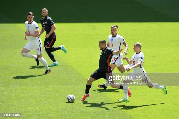 Mateo Kovacic of Croatia is chased by Kalvin Phillips of England and Phil Foden of England during the UEFA Euro 2020 Championship Group D match...