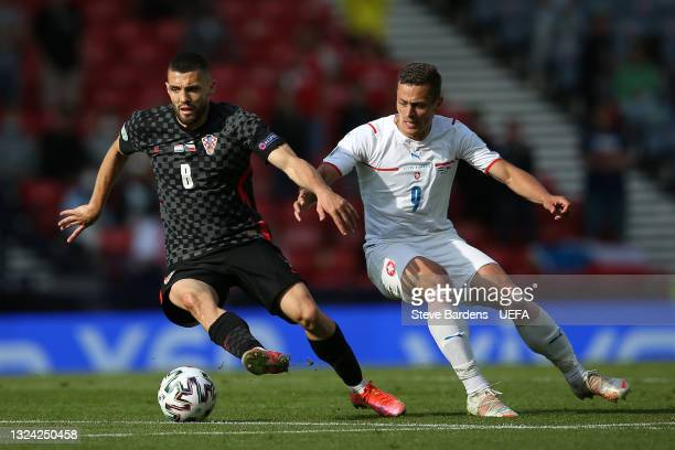 Mateo Kovacic of Croatia is closed down by Tomas Holes of Czech Republic during the UEFA Euro 2020 Championship Group D match between Croatia and...